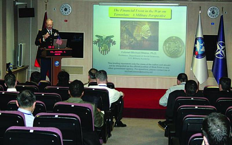 Col. Michael J. Meese, USA, gives a presentation on financial aspects in defense against terrorism. Cutting off the financial chain that supports terrorism is a long-standing effort, but now cyberspace has emerged as a tool for terrorist financial activities.