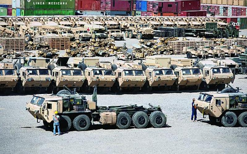 Rows of heavy vehicles fill a retrograde yard before shipment on Camp Warrior, Bagram Airfield, Afghanistan.