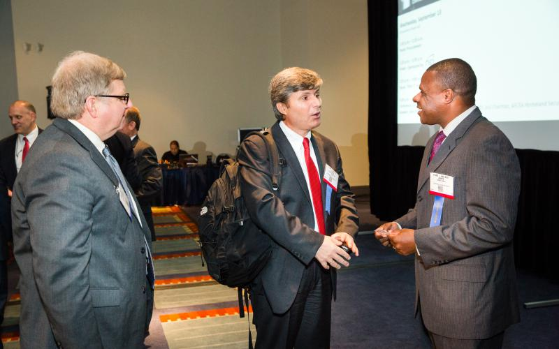 Andre Hentz, the U.S. Department of Homeland Security's acting deputy undersecretary for science and technology (r), says he is always interested in technology solutions that can help.