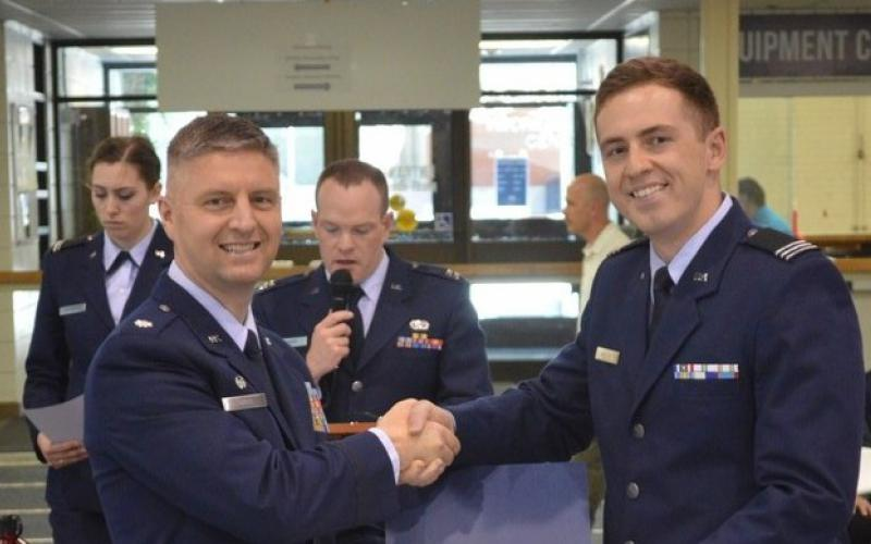 Cadet Eric C. Mielke, Air Force ROTC, Utah State University (r), receives an ROTC Honor Award from Lt. Col. Steven Smith, USAF, director of the university's Air Force ROTC program.