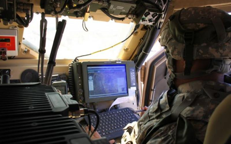 A Soldier from 2nd Brigade, 1st Armored Division uses the Joint Capabilities Release (JCR) during a U.S. Army Network Integration Evaluation (NIE). The successor to the Force XXI Battle Command Brigade and Below (FBCB2) system, the JCR will be a bridge to the Joint Battle Command-Platform, or JBC-P.