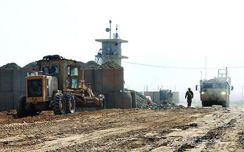 Heavy machinery from the 864th Engineer Battalion, U.S. Central Command Materiel Recovery Element, grade and pack the Afghan dirt as the engineer soldiers reconfigure an old retro sort yard into a material overflow yard.