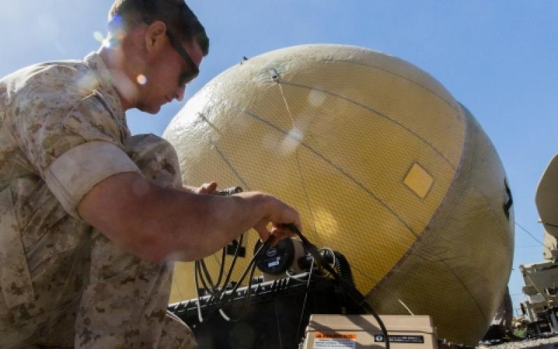 A satellite communications operator with the 11th Marine Expeditionary Unit (MEU) adjusts a 1.8-meter inflatable satellite communications dish during an exercise at Marine Corps Base Camp Pendleton, California. As the Marines augment the 11th MEU, their goal during the exercise was to standardize operating procedures and maintain functional command networks to prepare for MEU deployments.
