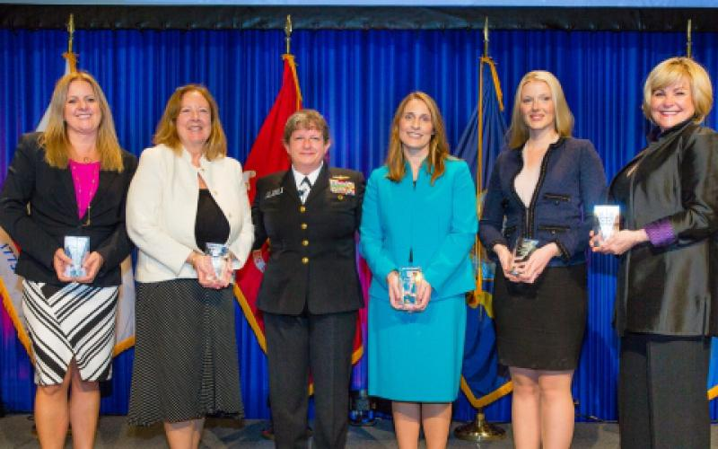 At the recent Women's Appreciation Event during the West Conference in San Diego, keynote presenter Rear Adm. Danelle Barrett, USN, Navy Cyber Security Division director (c), congratulates Women's Appreciation Award winners (from l) Tamara Greenspan, Kathleen Berganski, Ashley Becker, chair of Women in AFCEA, Abigail Wilson and Sharon O'Malley Burg.
