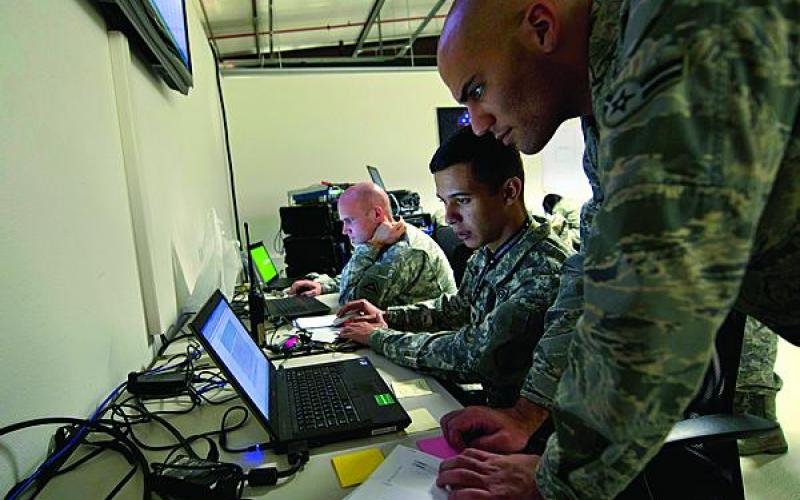 A U.S. Air Force airman reviews operations during a Combined Endeavor exercise in Grafenwoehr, Germany. The first phase of JIE implementation produced many advances being incorporated at U.S. facilities throughout the world.