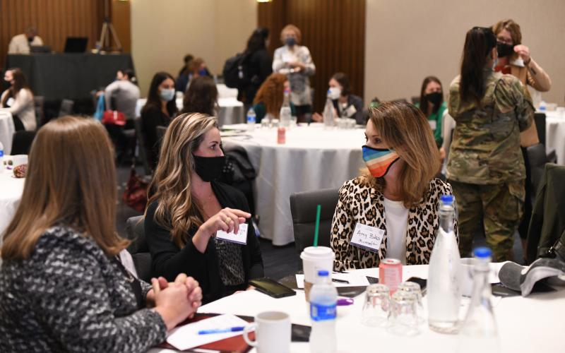 Attendees of Women in AFCEA's 2nd annual Women in the Workforce: A Journey in STEM 2021 conference partake in networking opportunities during the in-person event. Photo by Elizabeth Moon