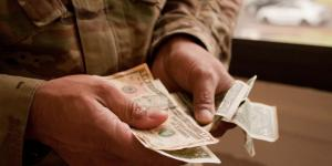 Money comes in many forms. Are paper bills or checks the safest way to pay? (U.S. Army photo by Kristen Wong)
