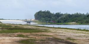 A U.S. Air Force F-22 Raptor assigned to the 525th Fighter Squadron completes agile combat employment (ACE) maneuvers during Operation Pacific Iron 2021 at Northwest Field, Guam, in July. The austere conditions of the former World War II airfield offered ideal conditions for airmen to train in ACE. Credit: Air Force photo by Senior Airman Alexandra Minor.