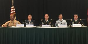 Cyber operators (l-r) Lt. Col. Barian Woodward, USMC; Lt. Col. Angela Waters, USAF; Lt. Col. Benjamin A. Ring, Ph.D., USA; Lt. Jr. Clovis Guevara, USCG; and Col. Paul T. Stanton, USA, panel moderator, address attendees at AFCEA's first Cyber Education, Research and Training Symposium.