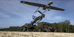 U.S. Army soldiers launch an unmanned aerial vehicle (UAV) for surveillance and reconnaissance in Germany. Research by the Intelligence Advanced Research Projects Activity (IARPA) aims to provide UAVs, along with various small handheld devices, with power sources providing twice the energy and 10 times the shelf life of conventional batteries in extreme environments. Credit: U.S. Army photo