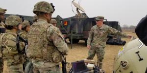 Capt. Zachary Schofield (center), USA, assistant product manager with Wideband Enterprise Satellite Systems, demonstrates an inflatable satellite antenna (ISA) to soldiers at Camp Humphreys, South Korea in 2019. The Army's Communications Electronics Command (CECOM) has a global support program in place to ensure communications equipment readiness. Credit: Amburr Reese, CECOM Public Affairs