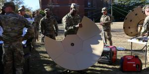A soldier from Company B, 50th Expeditionary Signal Battalion-Enhanced, tears down a Very Small Aperture Terminal (VSAT) satellite dish during a demonstration on November 29, 2018, at Fort Bragg, North Carolina. Army leaders are working to bring advanced communications technologies into an integrated network. U.S. Army photo by Amy Walker, PM Tactical Network PEO C3T public affairs