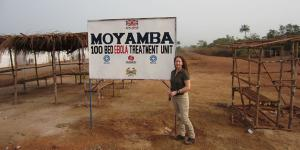 Paula Austin, a Sandia systems engineer within International Biological and Chemical Threat Reduction group, stands outside an Ebola treatment unit in Sierra Leone. (Image courtesy Sandia National Laboratories)