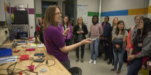 Caroline Scheck, a mechanical engineer with the Additive Manufacturing Project Office, tells middle- and high-school students with the Washington, D.C., Girls in Technology program about the Manufacturing, Knowledge and Education Lab, Naval Surface Warfare Center in March. (U.S. Navy photo by Dustin Q. Diaz/Released)