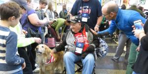 People young and old—and even golden retriever Biscuit—reached out to welcome World War II and Korean War veterans arriving at Reagan National Airport as part of the Honor Flight program.
