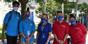 Dr. Irma Becerra, president, Marymount University (c), wears a face mask alongside orientation leaders and community assistants as Marymount students move back to campus for the fall 2020 semester.  Photo by Marymount University