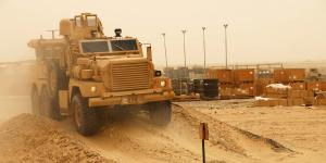 A Mine Resistant Ambush Protected (MRAP) vehicle tackles rough terrain during training at an air base in Southwest Asia.