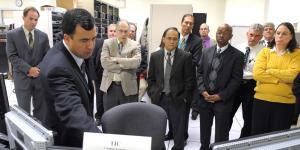 U.S. Navy personnel learn about the Office of Naval Research's suite of information technology tools designed to improve fleet operations.