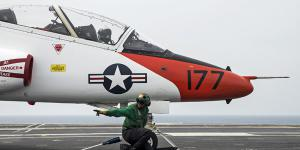 Navy Airman Raheem Malloy clears the catapult to launch a T-45C Goshawk on the flight deck of the aircraft carrier USS George Washington in the Atlantic Ocean in 2016. The Goshawk is assigned to Training Air Wing 1. Navy photo by Petty Officer 3rd Class Bryan Mai. Under its new contract with the Navy, L-3 Communications will support Goshawk aircraft systems.