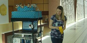 NIST researcher Jelena Senic drives a robot used to measure the performance of different antenna beam patterns. Photo Credit: NIST