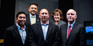 Tom Miller (c), CEO of ClearForce, stands with the judges who declared his firm's technology the winner in the second AFCEA Small Business Innovation Shark Tank Competition. Flanking Tom are (l-r) Glenn Hernandez, CISO, OpEdge Solutions LLC; Manoj Bhatia, president, Network Runners Inc.; Maria Horton, CEO of EmeSec; and Bill Jones, senior vice president of DSA's Integrated Solutions Group. Photo credit: Elizabeth Moon