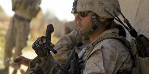 A U.S. Marine Corps sergeant performs a radio check during a security patrol in the Nawa district of the Helmand province, Afghanistan. Harris Corp. has been awarded a $1.7 billion contract to provide radios to Afghanistan under the Foreign Military Sales program.