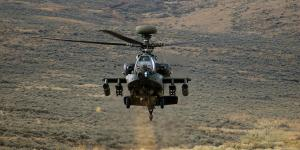 An AH-64 Apache rises from behind a hill during a training exercise at Yakima Training Center, Wash. Intevac Photonics was awarded a $12,626,081 firm-fixed-price contract with options for Electronic Image Intensifier Ship-Set for Lot 4, Apache AH-64D/E Program.