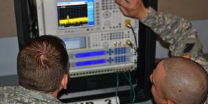 Two soldiers practice using electronic warfare equipment during a joint training exercise. EW often is overlooked, but its importance is increasing with advances in electronics.