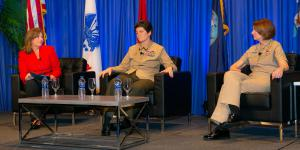 During a February 14 fireside chat at the West Conference, Lt. Gen. Lori Reynolds, USMC, deputy commandant for information, U.S. Marine Corps Headquarters (c), and Vice Adm. Nancy Norton, USN, director, DISA and commander of the Joint Forces Headquarters-Department of Defense Information Network (r), reflect on the challenges facing women in the military. DeEtte Gray, president of U.S. operations, CACI International and chairwoman of the AFCEA board, moderated the event. Credit: Michael Carpenter