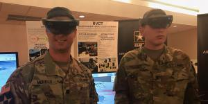Lt. Col. Dylan Morelle (l), USA, demonstration officer, Synthetic Training Environment Cross-Functional Team and Spc. Cody Palmer, USA, 2nd Armored Brigade Combat Team, 1st Infantry Division, demonstrate the Army's One World Terrain platform.