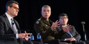 Gen. Paul Nakasone, USA (c), commander, U.S. Cyber Command, speaks on a panel at the Intelligence and National Security Summit. Photo by Herman Farrer