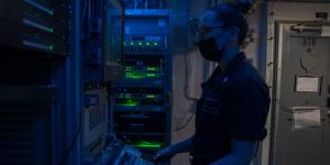 An information systems technician troubleshoots the automated digital network system aboard the USS Theodore Roosevelt. Greater network integration is vital to prevent an adversary from pre-empting a kinetic operation by purely a cyber attack. Credit: MC2 Mar'Queon Tramble, USN