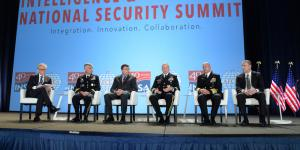 A phalanx of U.S. intelligence chiefs review the community's progress to close out the Intelligence & National Security Summit. Pictured are (l-r) panel moderator David Ignatius, associate editor and columnist, The Washington Post; Lt. Gen. Paul M. Nakasone, USA, commander, CYBERCOM and NSA; Christopher Scolese, director, NRO; Lt. Gen. Robert P. Ashley, USA, director, DIA; Vice Adm. Robert Sharp, USN, director, NGA; and Paul Abbate, associate deputy director, FBI. Credit: Herman Farrer Photography
