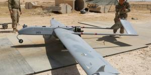 U.S. Army soldiers with Company D, 52nd Brigade Engineer Battalion, 2nd Infantry Brigade Combat Team, 4th Infantry Division, conduct a preflight inspection of an RQ-7B Shadow unmanned aerial system at a base in Iraq.