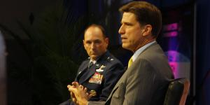 Dana Deasy, the new DOD CIO (r), chats with Brig. Gen. Kevin B. Kennedy, USA, during the Defensive Cyber Operations Symposium.