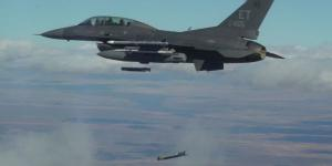 Collaborative small diameter bombs are launched from the wing of an F-16 fighter. Four of the bombs were dropped during the second flight demonstration of the Air Force Golden Horde Vanguard in March.  U.S. Air Force
