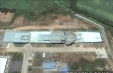 Satellite imagery of a land-based mock-up of China's new 055 warship shows advanced radar on a bridge structure positioned for electromagnetic interference testing. The 055 is being designed to serve as a key escort for a People's Liberation Army Navy aircraft carrier task force.