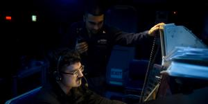 Two U.S. Navy operations specialists stand watch aboard the USS Dwight D. Eisenhower. The Navy must provide cybersecurity for major systems aboard ships as well as for smaller logistical systems, all of which are targets for digital adversaries.  U.S. Navy photo