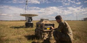 Airman 1st Class William King, USAF, technician, 352nd Special Operations Support Squadron, troubleshoots a modem connected to a parabolic dish in August, at RAF Mildenhall, England. JADC2 relies on globe-spanning high bandwidth links like these. U.S. Air Force photo by Airman 1st Class Joseph Barron