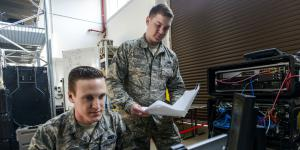 U.S. Airmen with the 1st Combat Communications Squadron review their systems against technical guides during a cybersecurity audit in March at Ramstein Air Base, Germany. Photo by Staff Sgt. Timothy Moore, USAF