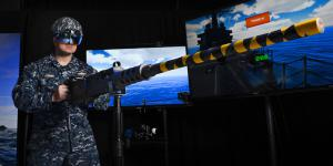 Lt. Steven McGhan, USN, demonstrates a gun-augmented reality system at Trident Warrior 2017. In support of the Navy's Optimized Fleet Response Plan, the Naval Information Warfighting Development Center (NIWDC) uses live, virtual and constructive training capabilities like these to effectively train the fleet. Navy photo by Alan Antczak