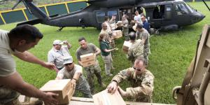 U.S. Army soldiers unload critical supplies in Puerto Rico. The Army also is providing satellite communications in support of hurricane relief efforts in Puerto Rico and the U.S. Virgin Islands.