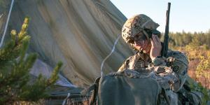 A U.S. Army paratrooper communicates by radio during a drop in Latvia. Traditional radio and network status information will play a key role in cyber situational awareness in the digital battlespace. Credit: Army photography by Spec. Dustin Biven, USA
