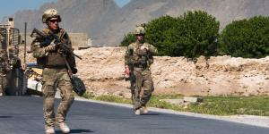 Two U.S. soldiers prepare to clear improvised explosive devices (IEDs) from a polling area in Afghanistan. Many of the processes the Joint Improvised-Threat Defeat Agency (JIDA) uses to bring useful technologies and systems to the field quickly can be applied to acquisition reform efforts throughout the U.S. Defense Department.