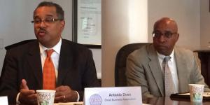 Antonio Doss (l), district director of the SBA's Washington Metropolitan Area District Office, talks about a major rule change during AFCEA's Small Business Committee meeting.