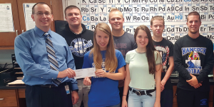 STEM teacher Ray Johnston and his Chem-Science Club students at Hancock Middle/Senior High School in Maryland show his $1,000 Gravely Grant.