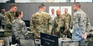 Maj. Gen John C. Harris Jr., ANG (c), the adjutant general, Ohio National Guard, observes training while the Cyber Mission Assurance Team (CMAT) conducts network assessments during exercise week of Cyber Shield 19 at Camp Atterbury, Indiana. The National Guard is standing up the teams to help secure the critical infrastructure that services U.S. Defense Department installations. U.S. Army National Guard Photo by Staff Sgt. George B. Davis