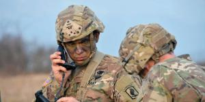 U.S. soldiers conduct a communications check during an exercise. The Army is implementing a plan for restructuring its battlespace network after years of ad hoc changes in Southwest Asia. Army photography by Lt. Col. John Hall, USA.