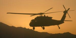 A UH-60 Black Hawk helicopter carries soldiers from the 10th Mountain Division on a mission in Afghanistan. The Afghan Mission Network provides unprecedented data sharing and operations planning capabilities among coalition partners and serves as the basis for the Mission Partner Network in development today.