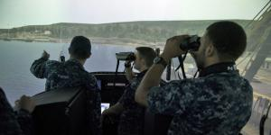 Sailors assigned to the Gold crew of the guided-missile submarine USS Ohio test the new submarine bridge trainer at Trident Training Facility Bangor in Washington.